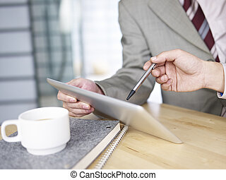 business persons working in office with tablet computer