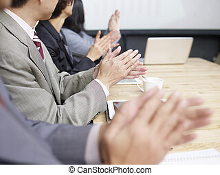 business meeting - business people applauding during...