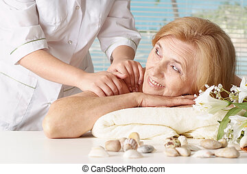 elderly woman in the spa salon - Beautiful Caucasian elderly...