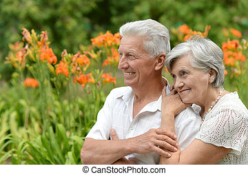 loving elder couple on a background of flowers