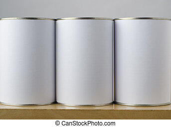 Three Tin Cans with White Labels - Conceptual image of three...