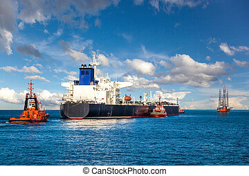 Tugboat towing a tanker - Oil Platform and Tanker in the...