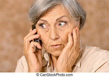 Aged woman talk on phone - Portrait of worried elderly woman...