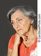 Sad elderly woman - Portrait of upset elderly woman on white...