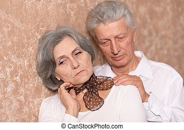 Portrait of an elder couple - Close-up portrait of a sad...