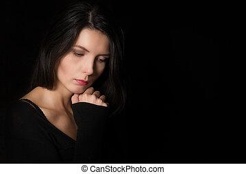 Beautiful introspective woman - Dark atmospheric portrait of...