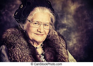 old madam - Portrait of a beautiful old lady in an elegant...
