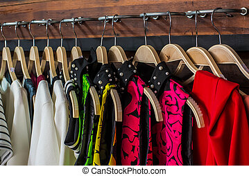 Blouses - Many blouses on hangers in the dressing room
