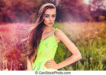 Beautiful fashion woman posing outdoors
