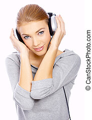 Girl with headphones - Beautiful young lady is listen to the...