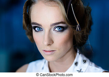 Beautiful fashion woman with blue eyes and makeup