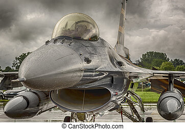 F16 Fighter Jet - F16 Fighter jet shown against stormy skies...