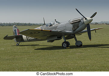 Vintage Spitfire parked on grass