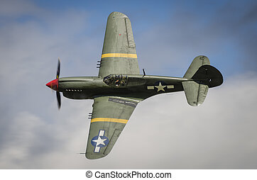Curtiss P40 Warhawk in flight against blue sky