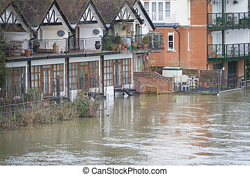 Flooded homes on bank of River Thames winter 2014
