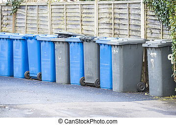 Waste bins - Line up of watse 'wheelie' bins in UK street