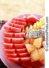 Various fruit slices on plate.