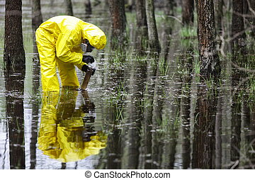 in floods contaminated area - technician taking sample of...