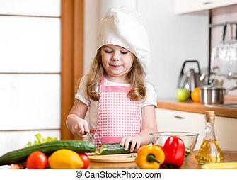 Chef girl preparing healthy food at kitchen