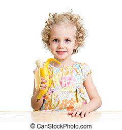 kid girl eating banana