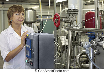 milk factory - worker on a modern milk factory