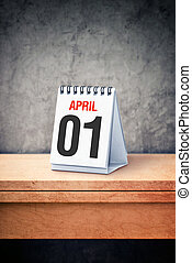 April the first, Fool's day, on table calendar - It's April...