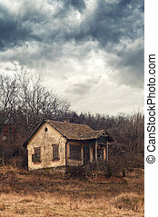 Old abandoned house. Crumbling old house in rural field in...