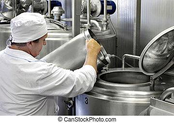 modern milk factory - worker on a modern milk factory