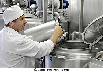 worker on a milk factory  - worker on a modern milk factory