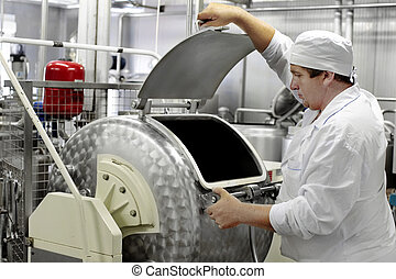 worker on a milk factory - Modern Dairy food-processing...