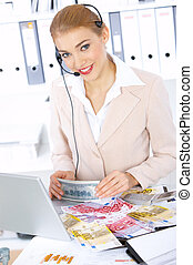 Business Woman in Office - Business woman with lots of money...