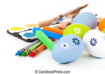 painting easter eggs on a white background.