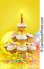 Lots of cupcakes on yellow background