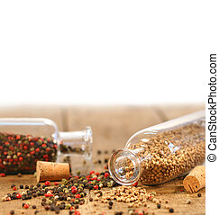 Bottles of spices on rustic table