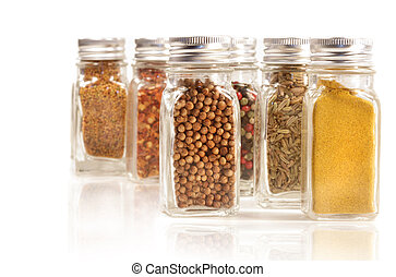 Assorted spice jars isolated on white background