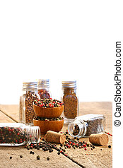 Spice bottles on rustic table