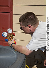 HVAC Tech Working - Air conditioning technician checking...