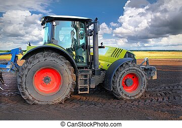 Tractor on the field while he was plowing