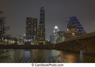 Partial skyline of Austin, Texas at night - HDR image of a...