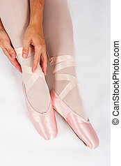 Ballerina sit down on floor to put on slippers prepare for perform from above