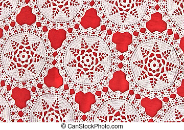 Handmade white lace on red background