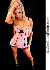 Pink Lingerie Pose - Portrait of an attractive young blond...