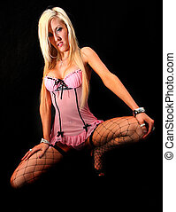 Pink Lingerie Girl - Portrait of an attractive young blond...