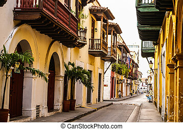 Typical street scene in Cartagena, Colombia of a street with...