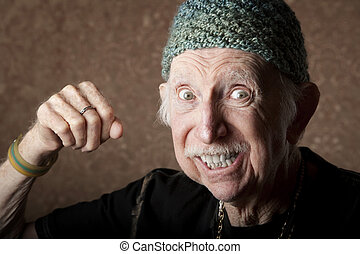 Angry Old Man - Senior man in knit cap making a fist