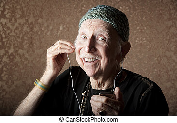 Elderly Hiptser Listening to Handheld Audio Device - Elderly...