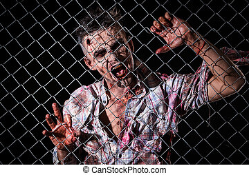Scary zombie cosplay - Creepy zombie behind the fence