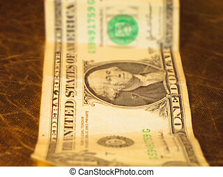Dollars - A filtered view of a pile of United States dollar...