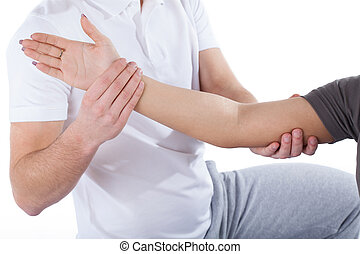 Physiotherapy, doctor, examining, woman's, elbow