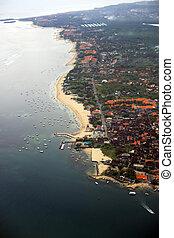 Coast of island of Bali - Kind at coast of island of Bali...